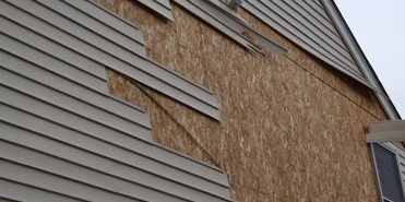 Siding damage from a wind storm in Frederick MD